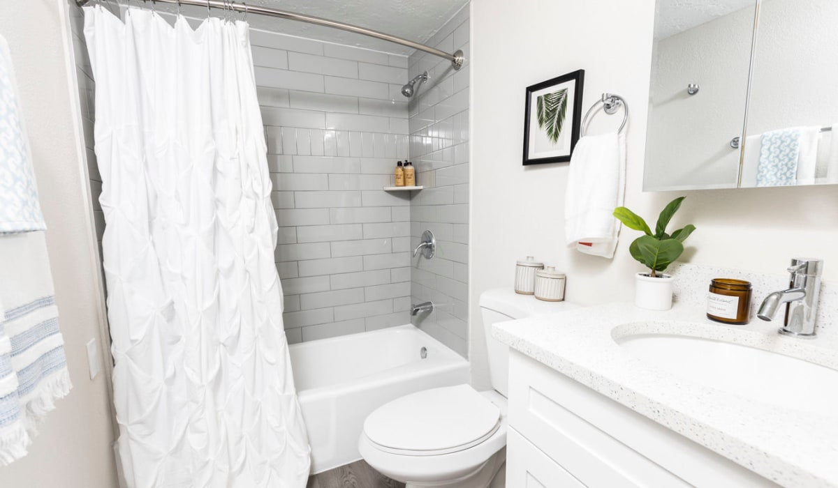 Bright model bathroom with oval tub at The Wayland in St Petersburg, Florida