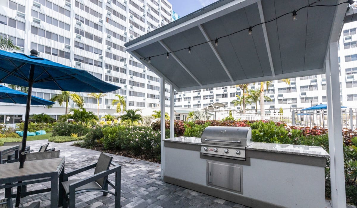 Outdoor barbecue and umbrella chair seating at The Wayland in St Petersburg, Florida