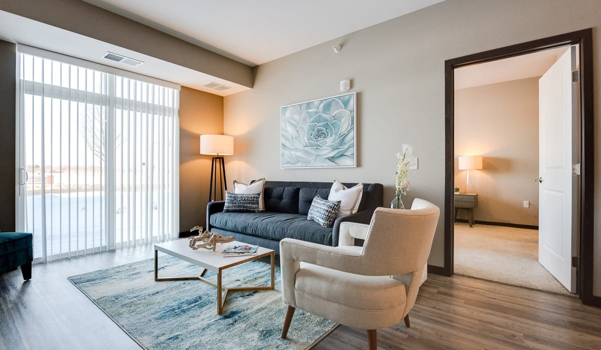 Spacious living room with patio access at Remington Cove Apartments in Apple Valley, Minnesota