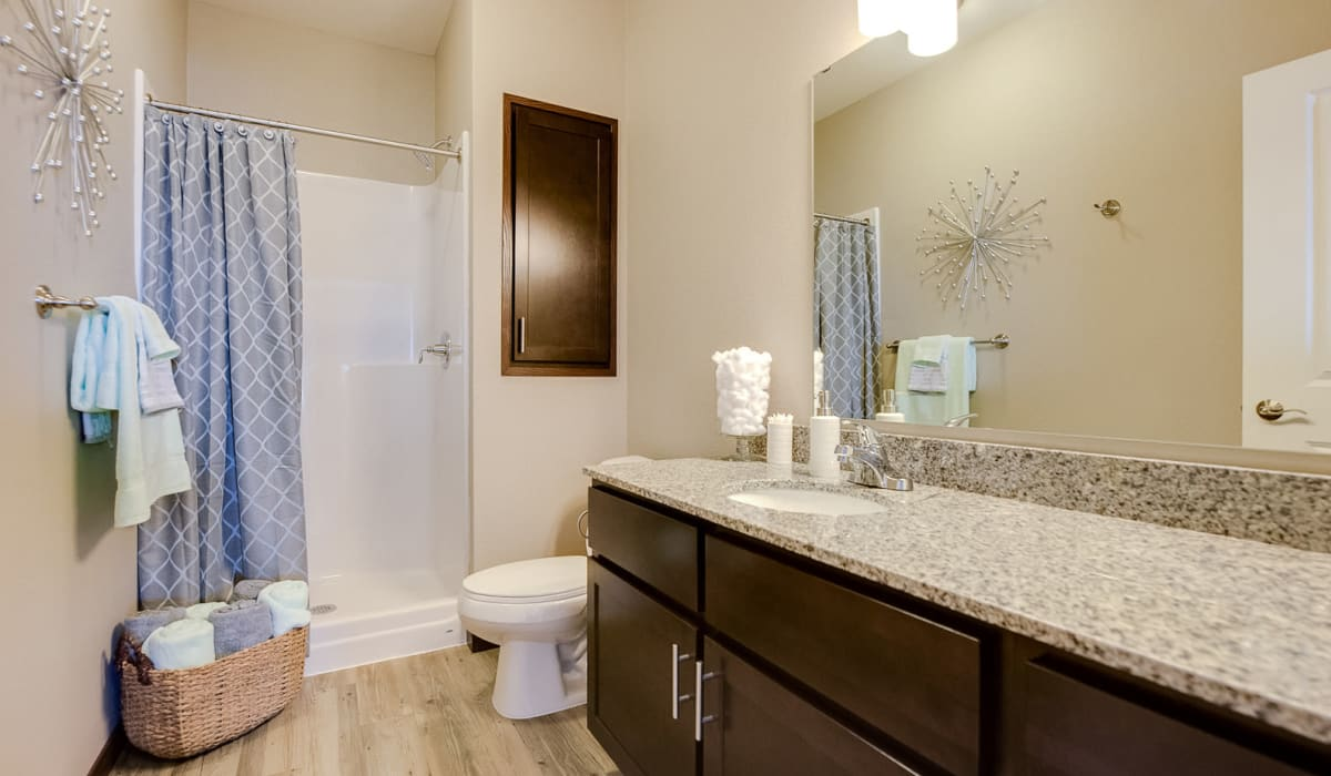 Bathroom with a large vanity at Remington Cove Apartments in Apple Valley, Minnesota