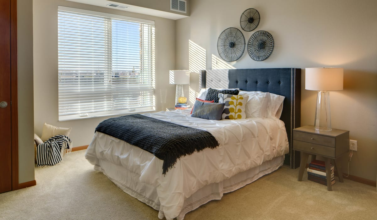 Main bedroom with a large window at Remington Cove Apartments in Apple Valley, Minnesota