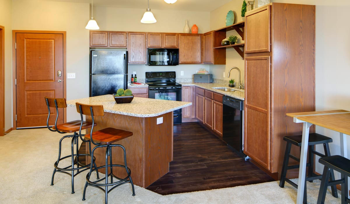 Standard kitchen with a breakfast bar at Remington Cove Apartments in Apple Valley, Minnesota
