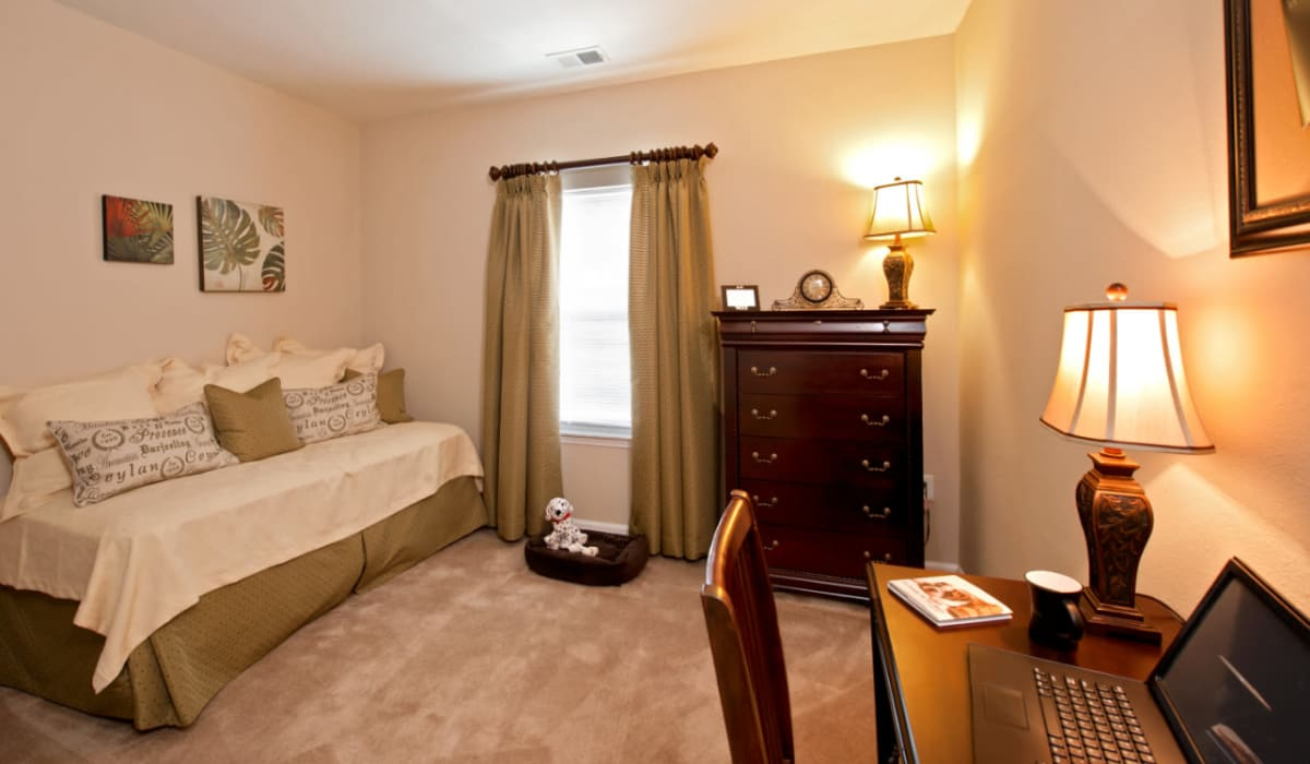 A spacious bedroom with a window at Meridian Watermark in North Chesterfield, Virginia