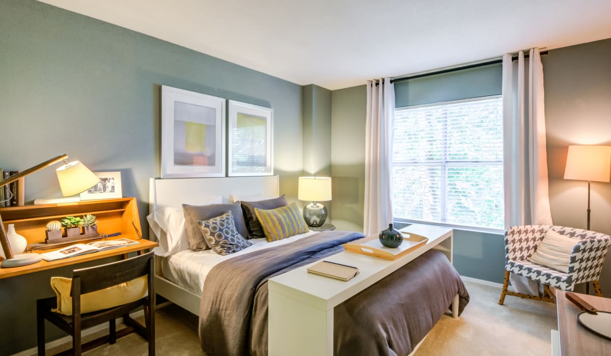 A spacious bedroom with a large window at Residences at Belmont in Fredericksburg, Virginia