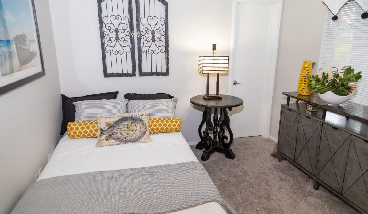 A cozy bedroom with plush carpeting at Sunbrook Apartments in Saint Charles, Missouri