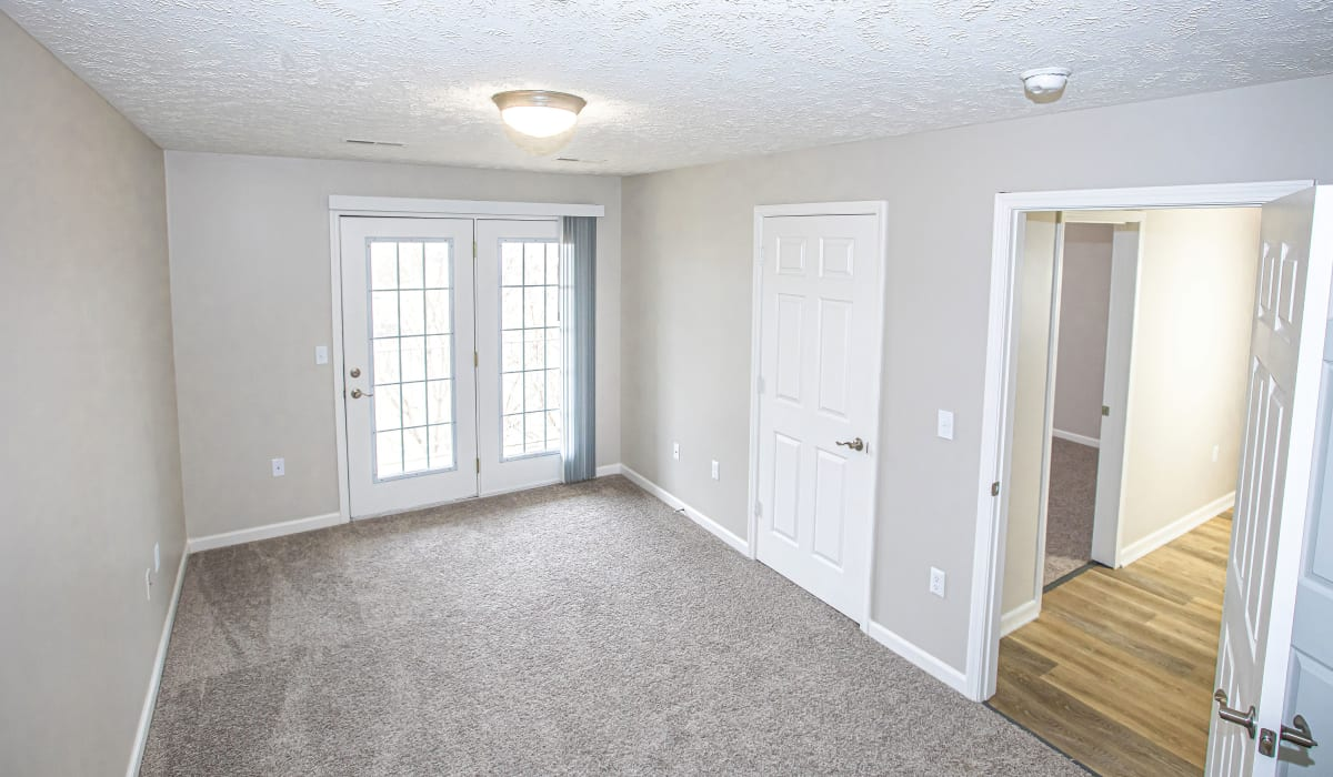 A bedroom with patio access at Silver Lake Hills in Fenton, Michigan