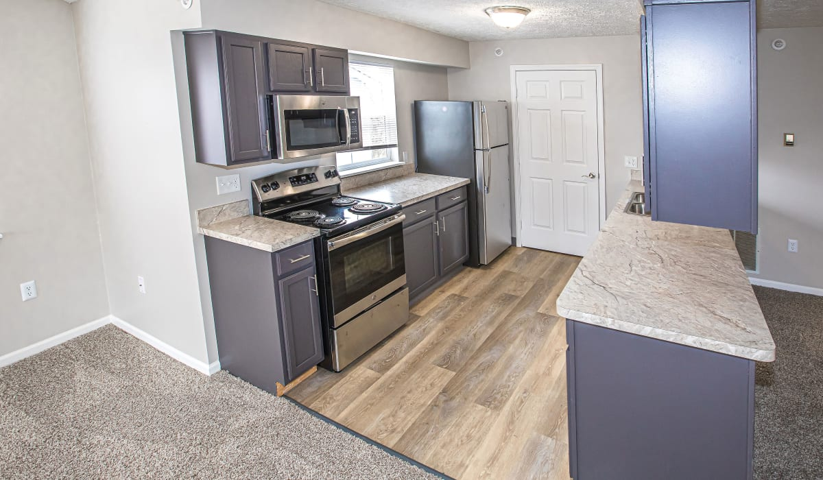 A kitchen with stainless-steel appliances at Silver Lake Hills in Fenton, Michigan