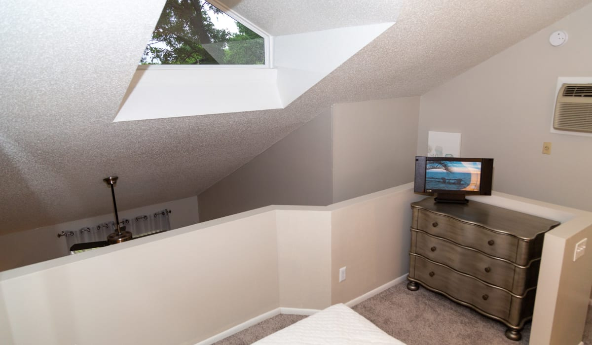 A bedroom with a skylight at Sunbrook Apartments in Saint Charles, Missouri