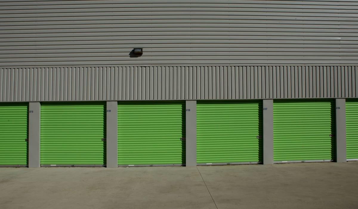 Green exterior units of Midgard Self Storage in Florence, Alabama