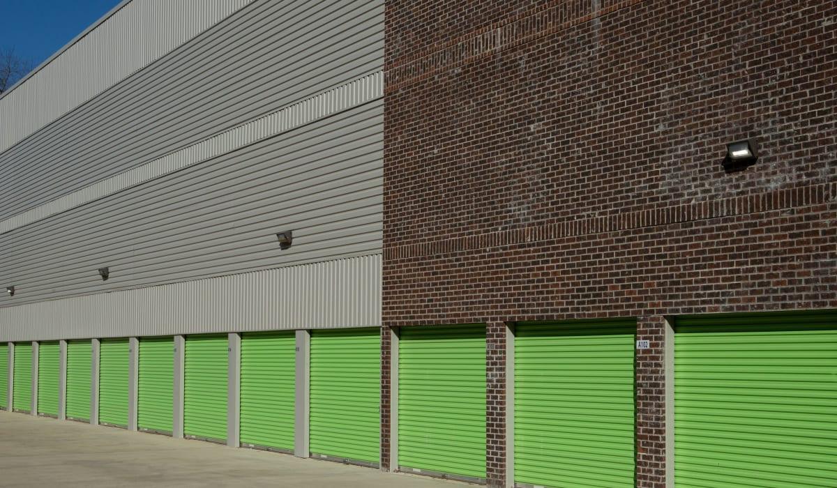 Green doors at Midgard Self Storage in Florence, Alabama