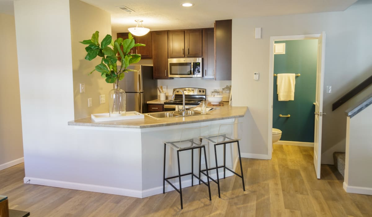 A spacious kitchen with an island at Metro on 5th in Saint Charles, Missouri