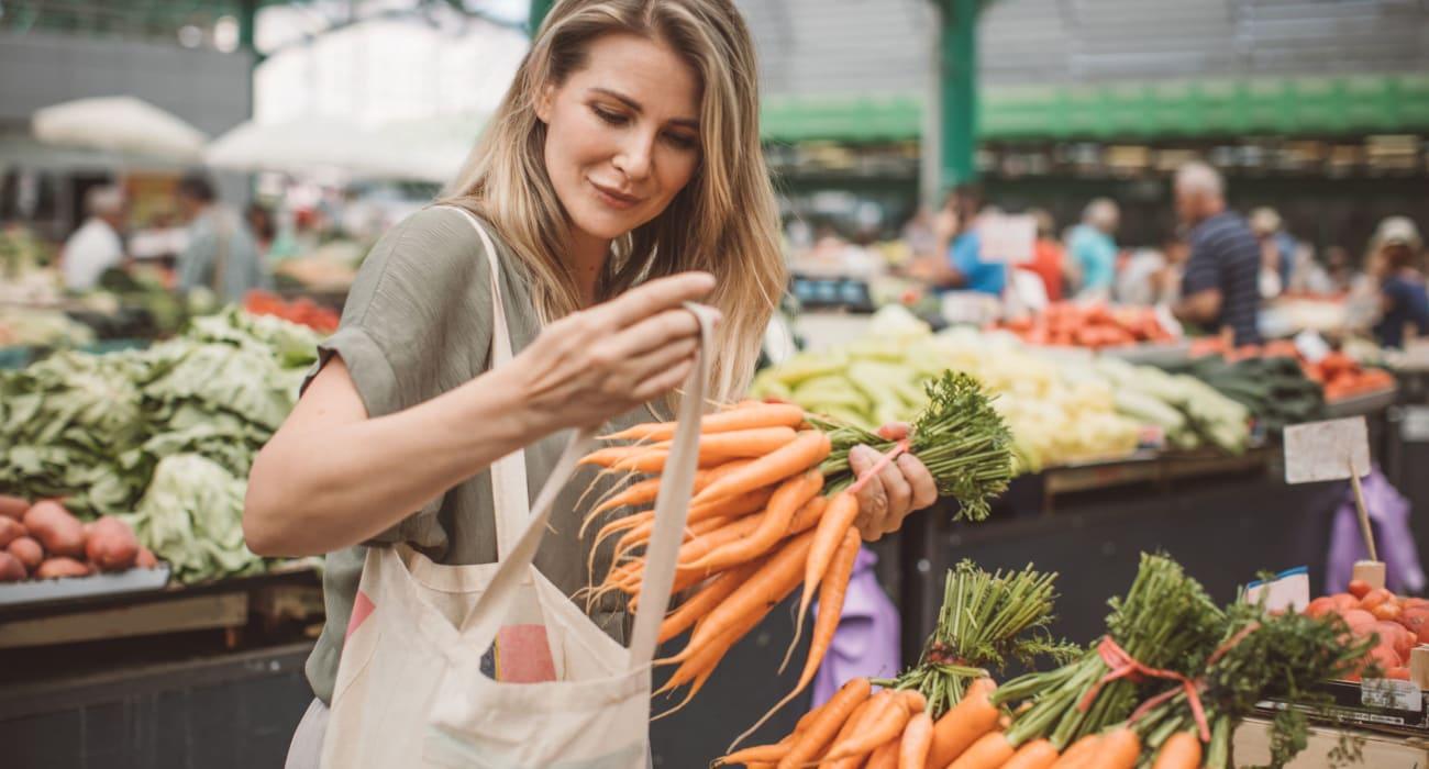 Resident shopping for produce in Bethlehem, Pennsylvania near Lehigh Plaza Apartments
