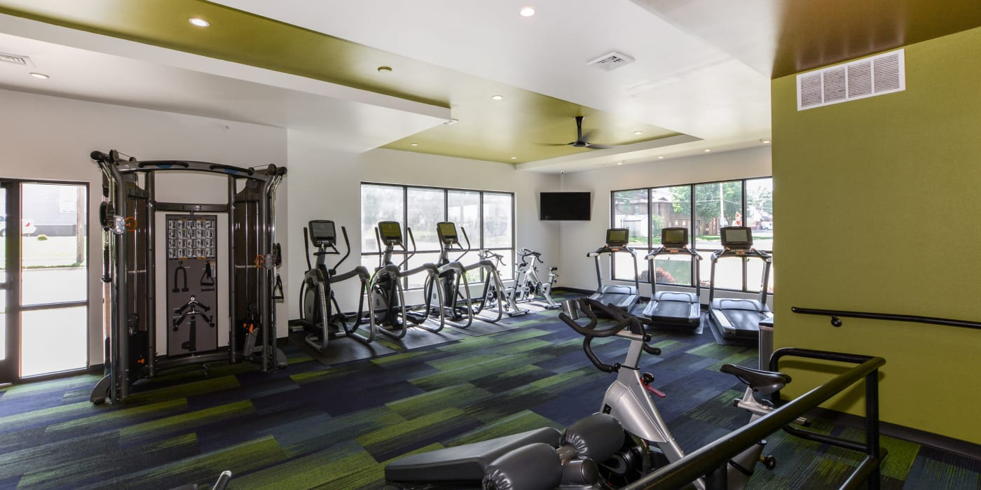 A fitness center with lots of individual workout stations at Beacon Springfield in Springfield, Missouri