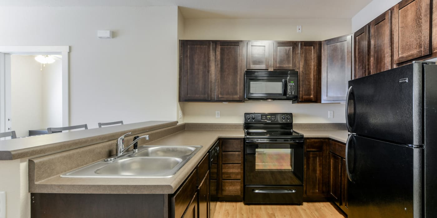 A kitchen with plenty of countertop space at Beacon Springfield in Springfield, Missouri