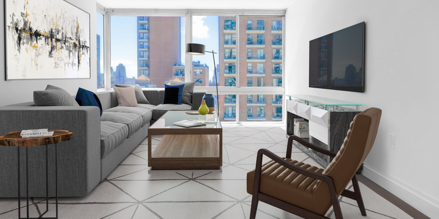 Very open living room with a tv mounted on the wall at The Ventura in New York, New York