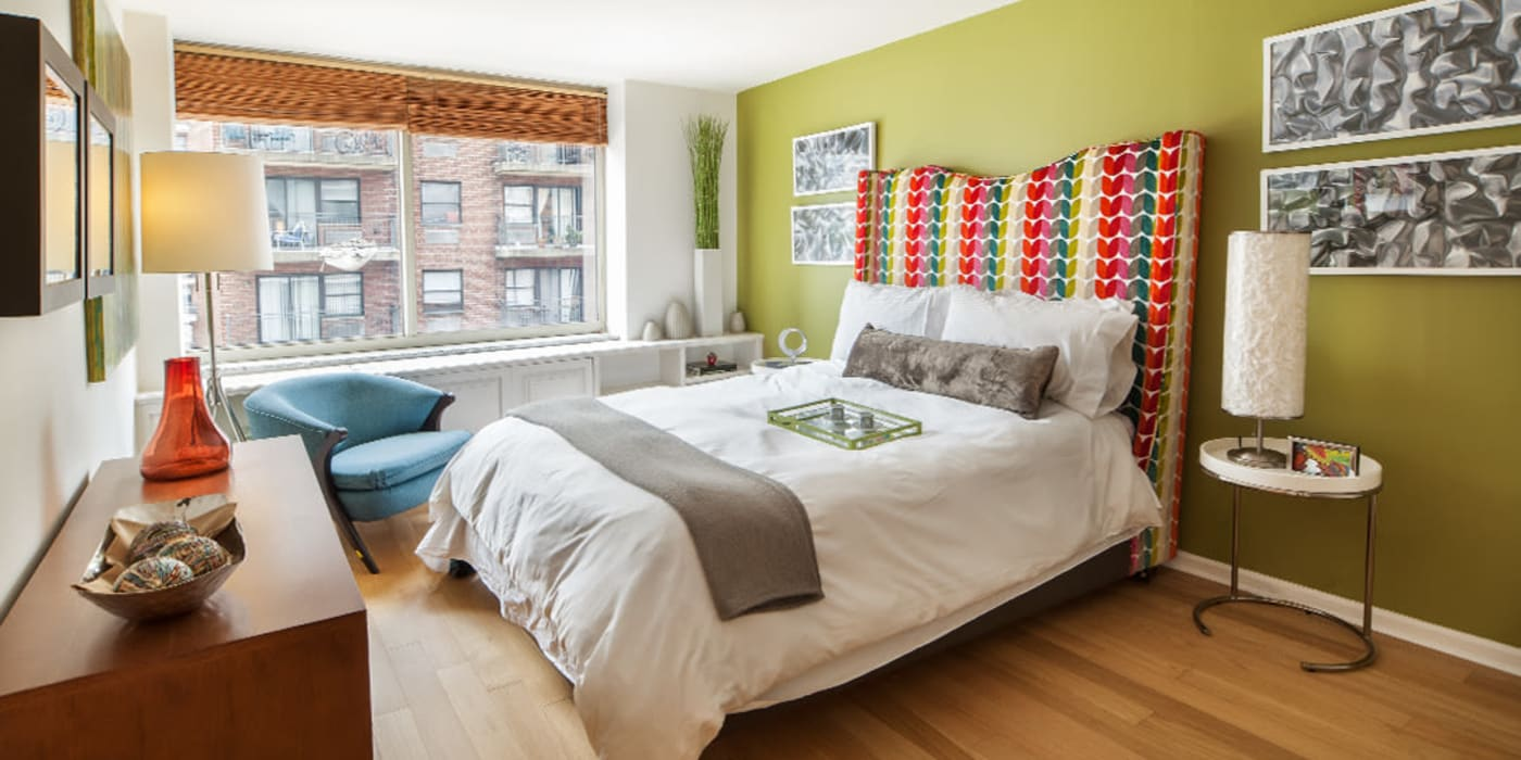 Cute bedroom with wood style flooring at The Ventura in New York, New York