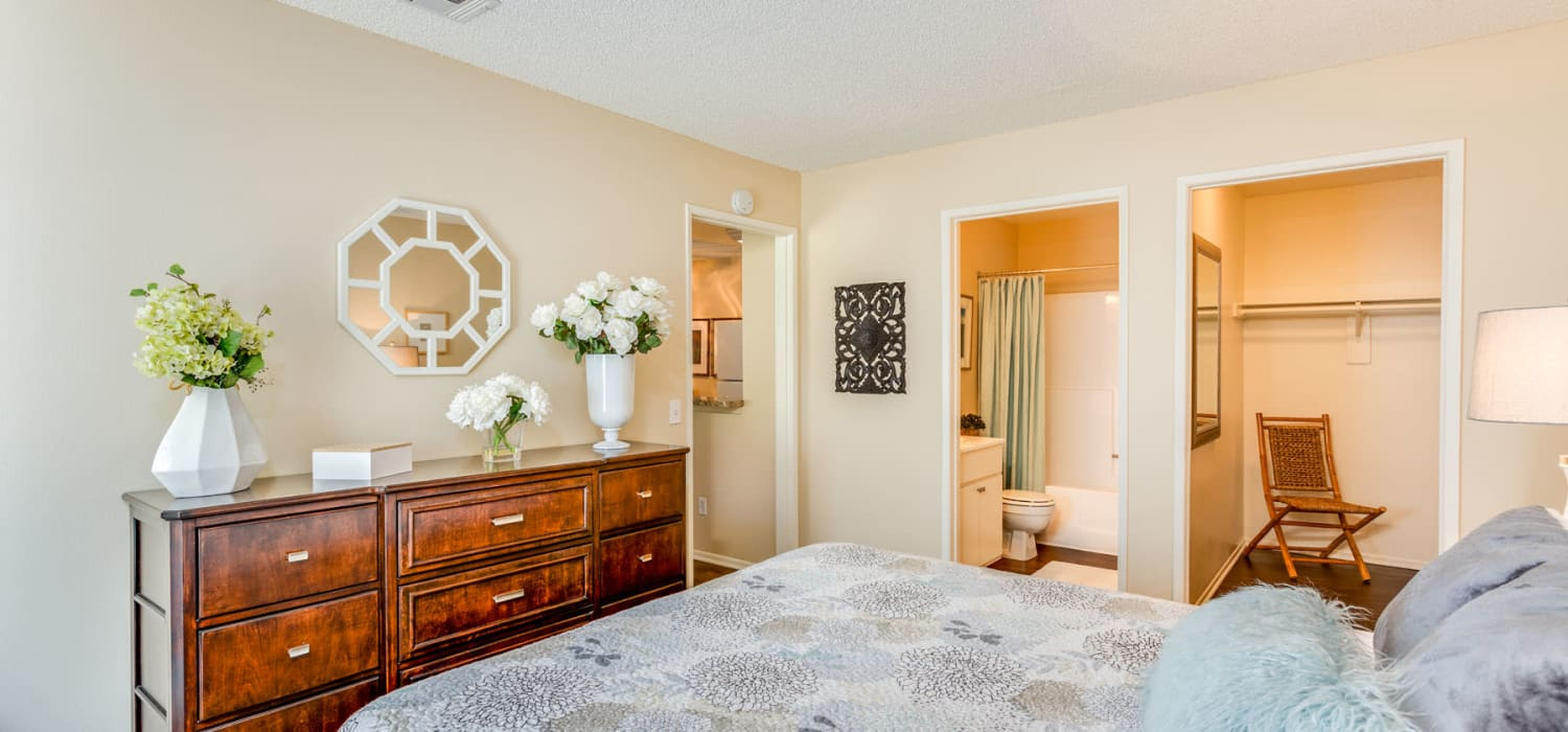 Spacious primary bedroom with a walk-in closet and en suite bathroom at Mountain Vista in Victorville, California