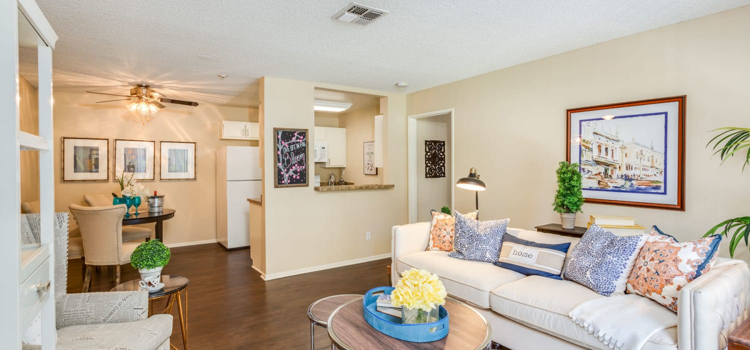 Classically furnished model home's open-concept living area with beautiful hardwood flooring at Mountain Vista in Victorville, California