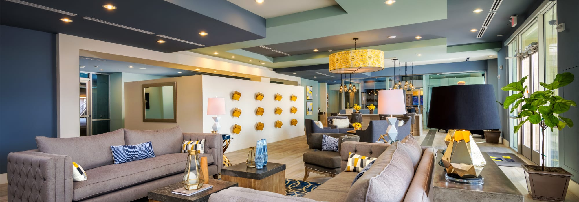 Comfortable seating and contemporary decor in the resident clubhouse at Capital Place in Phoenix, Arizona