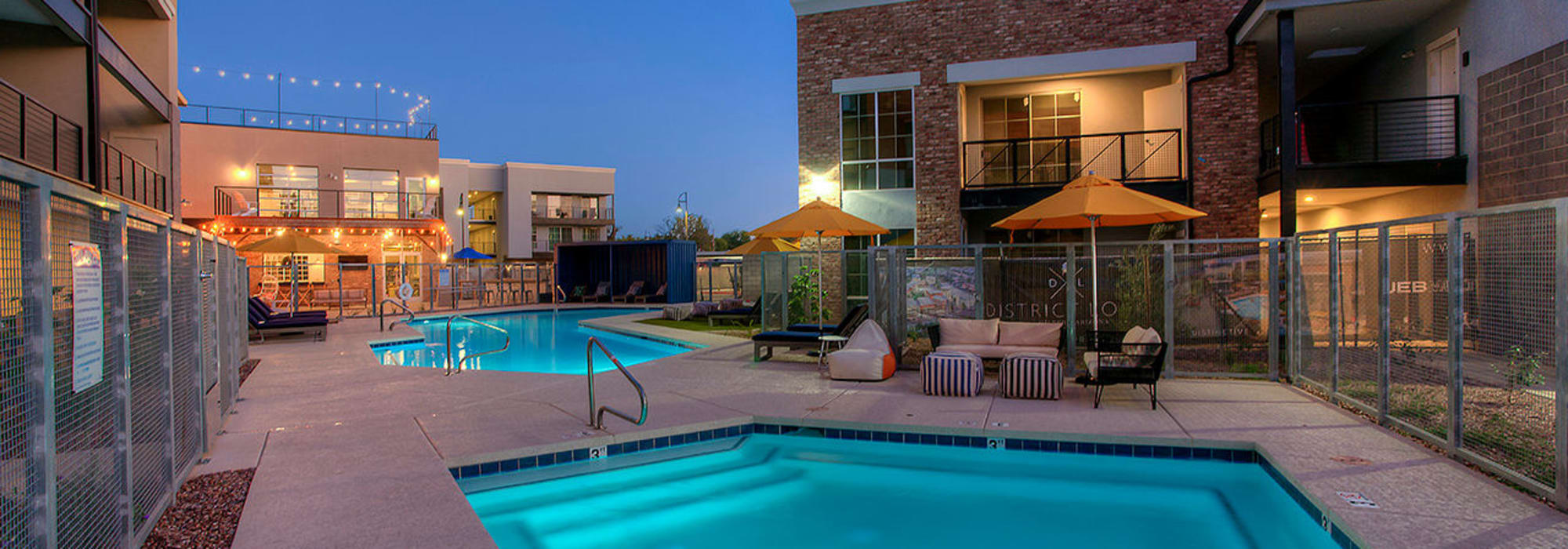 Swimming pool area at dusk at District Lofts in Gilbert, Arizona
