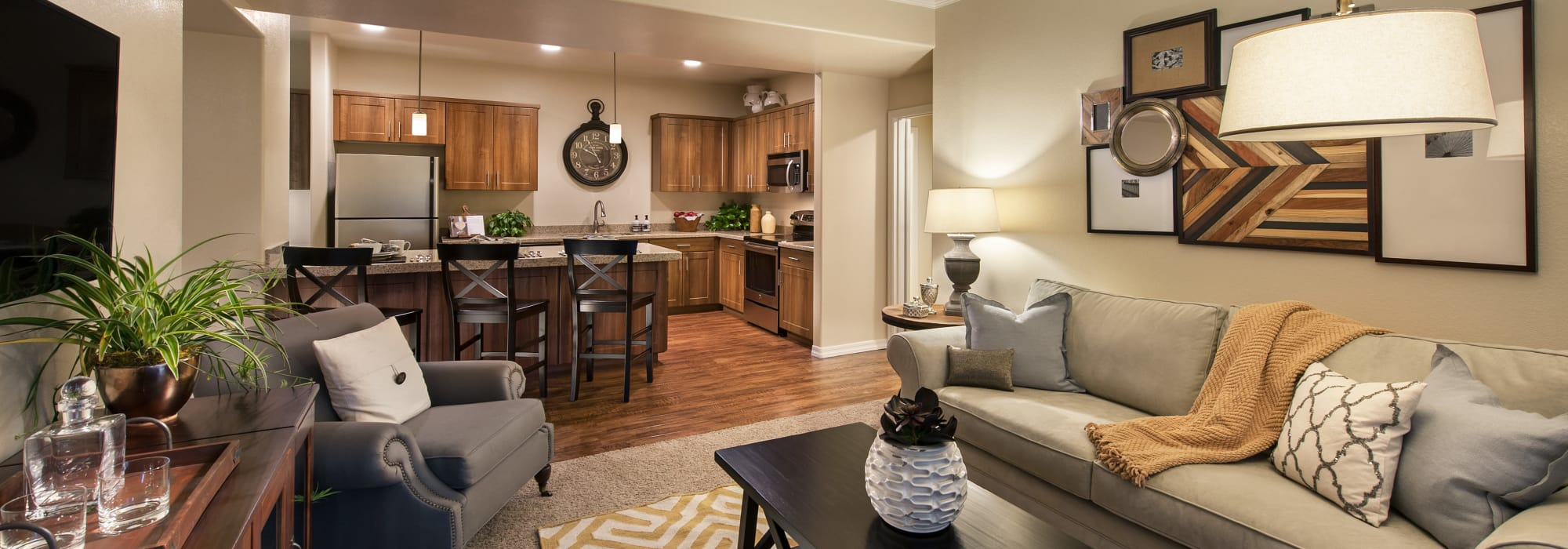Well-decorated living area in open-concept floor plan of model home at San Paseo in Phoenix, Arizona