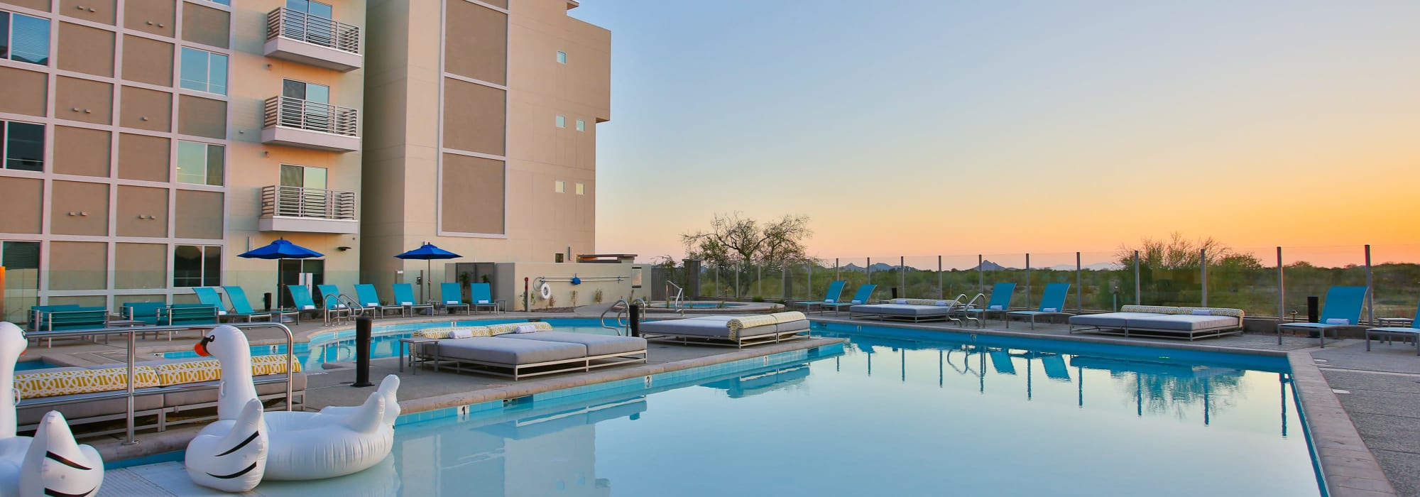 Swimming pool area at dawn at Slate Scottsdale in Phoenix, Arizona
