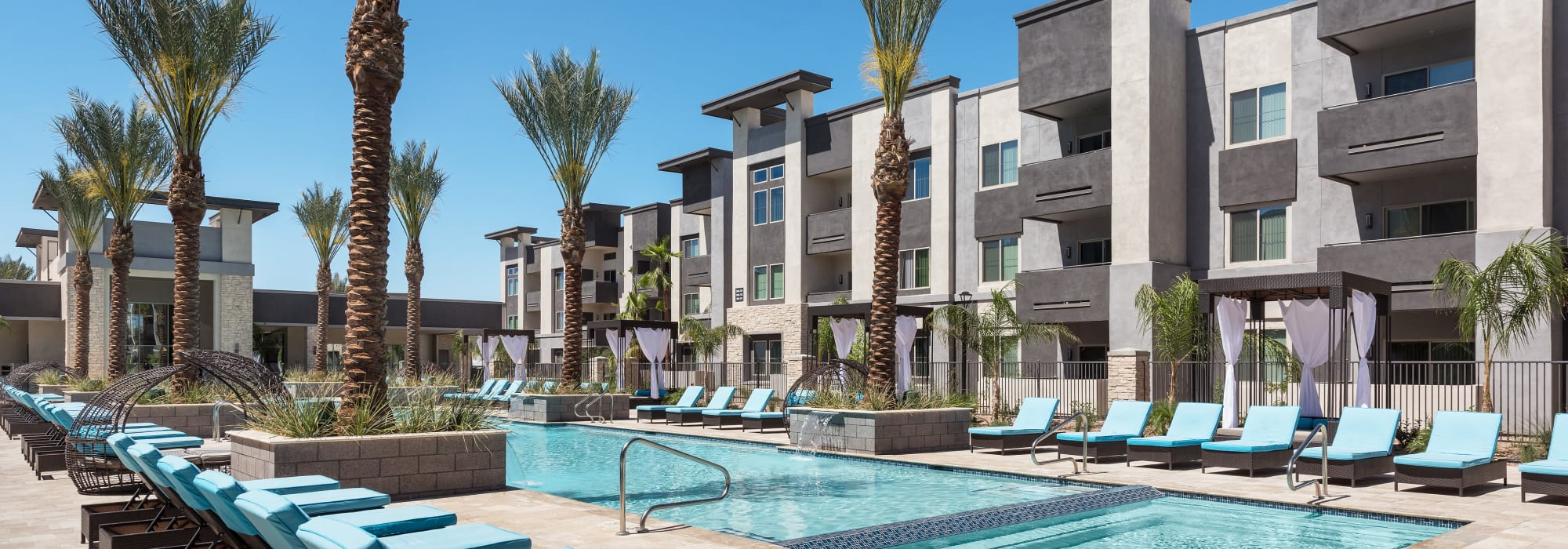 Poolside with lounge chairs at Aviva in Mesa, Arizona