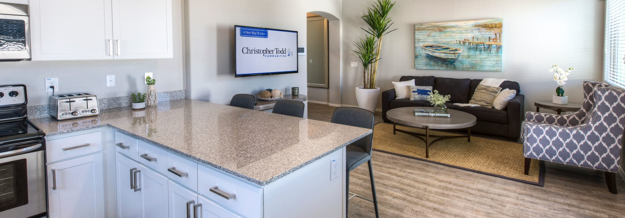 Kitchen leading into the living room at Christopher Todd Communities on Greenway in Surprise, Arizona