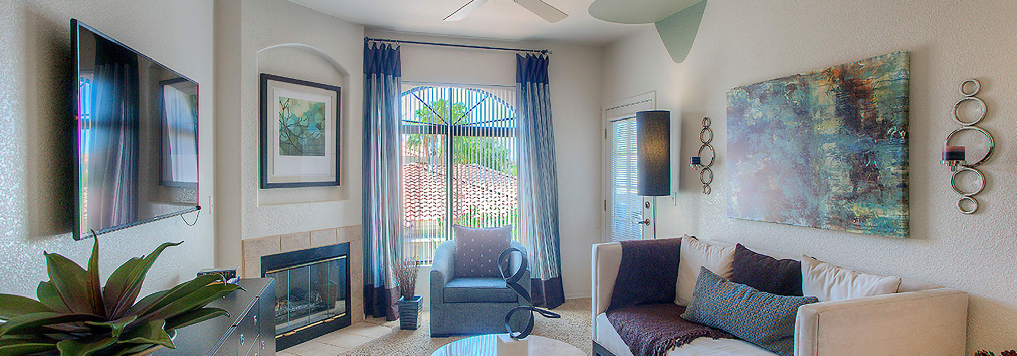 Living room with a fireplace in a model home at San Pedregal in Phoenix, Arizona