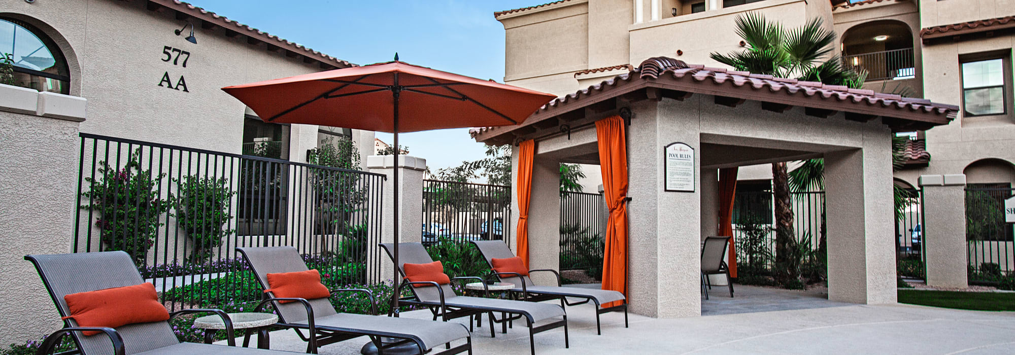 Chaise lounge chairs and covered cabanas near the pool at San Marquis in Tempe, Arizona
