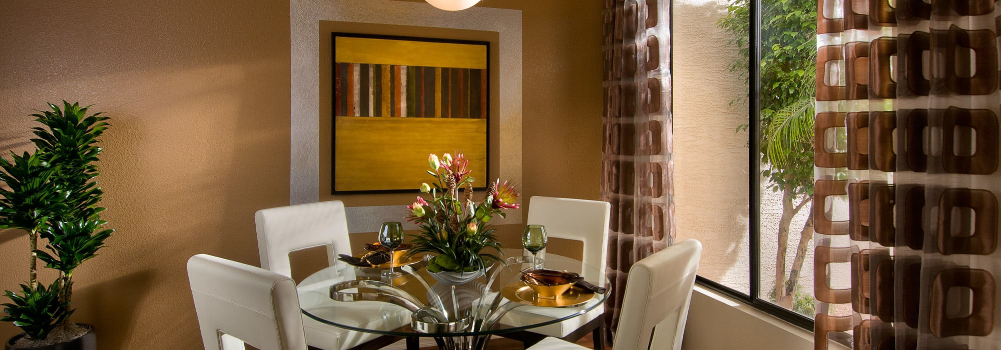Dining nook with fine furnishings in a model home at San Palmilla in Tempe, Arizona