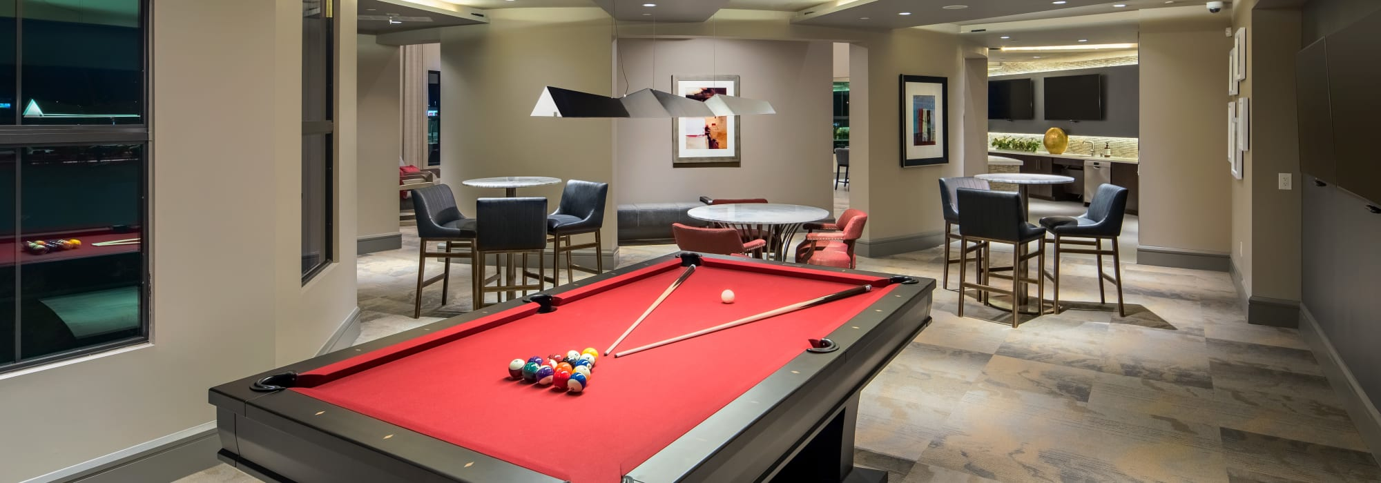 Luxurious game room with billiards table and more at The Core Scottsdale in Scottsdale, Arizona