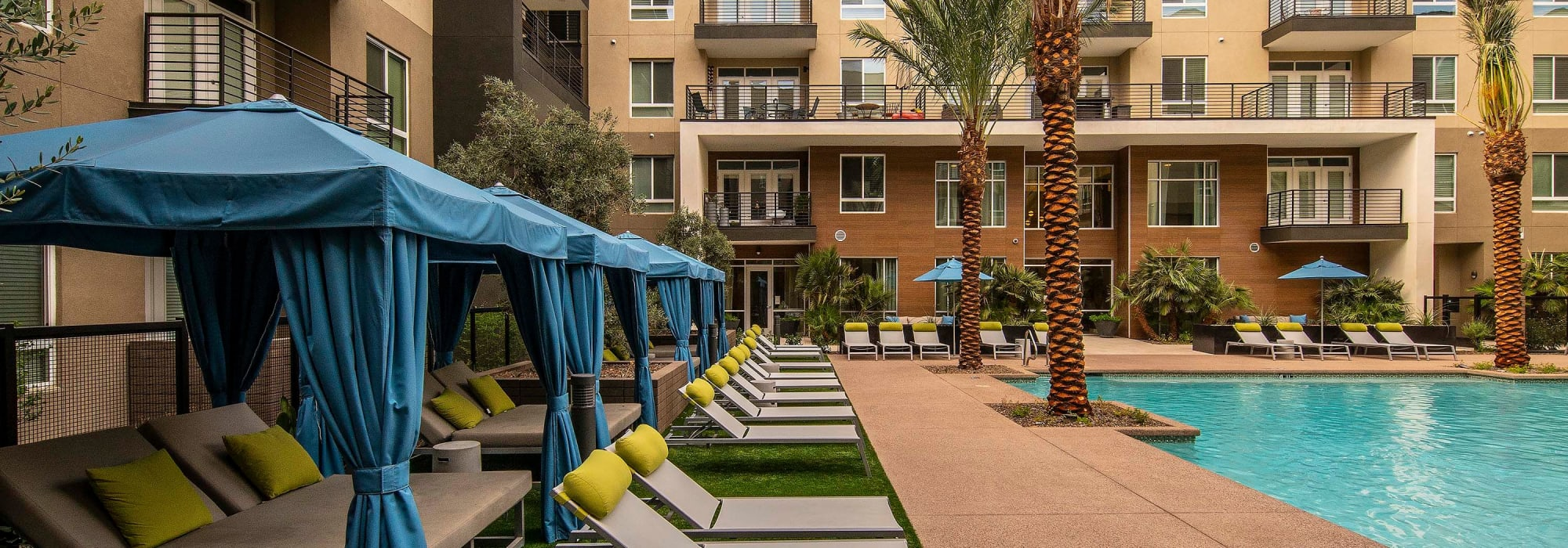 Resort-style swimming pool with chaise lounge chairs at Carter in Scottsdale, Arizona