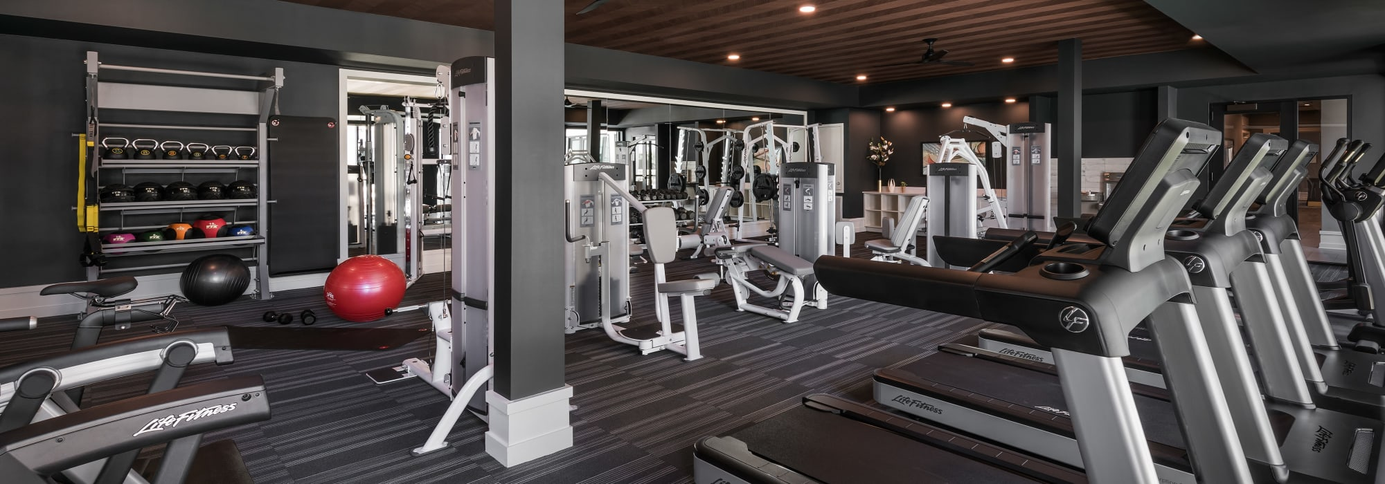Resident fitness center with equipment at The Astor at Osborn in Phoenix, Arizona