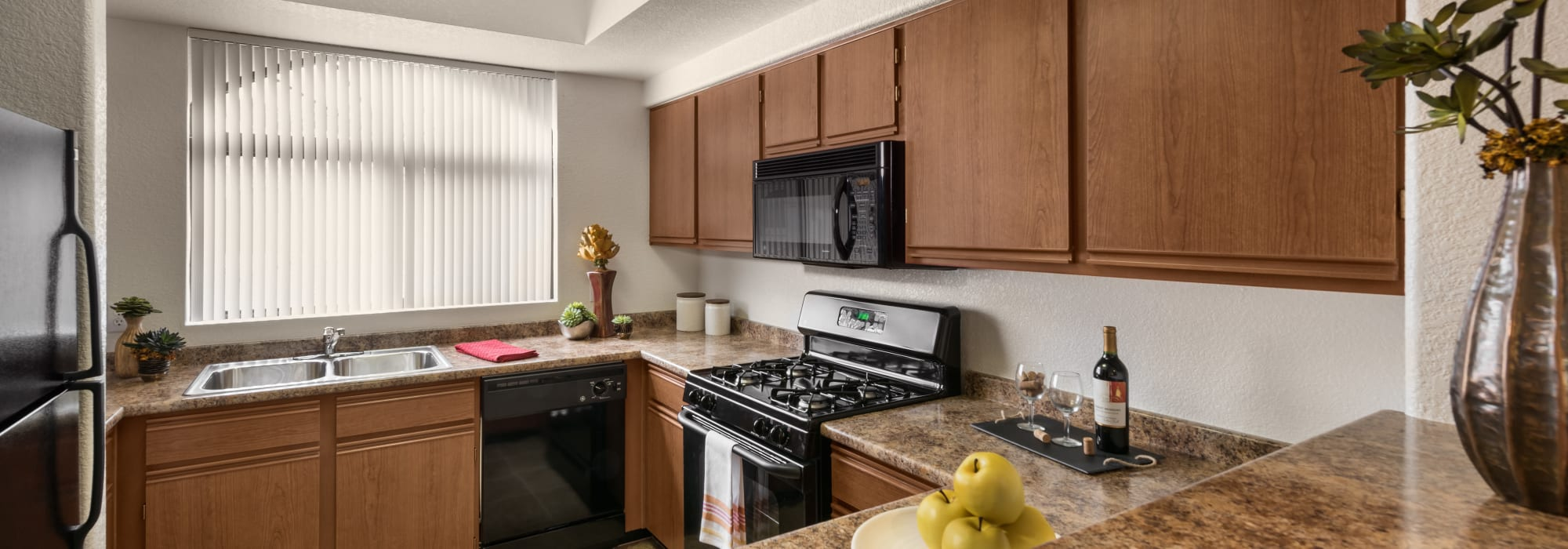 Upgraded kitchen with appliances at San Prado in Glendale, Arizona