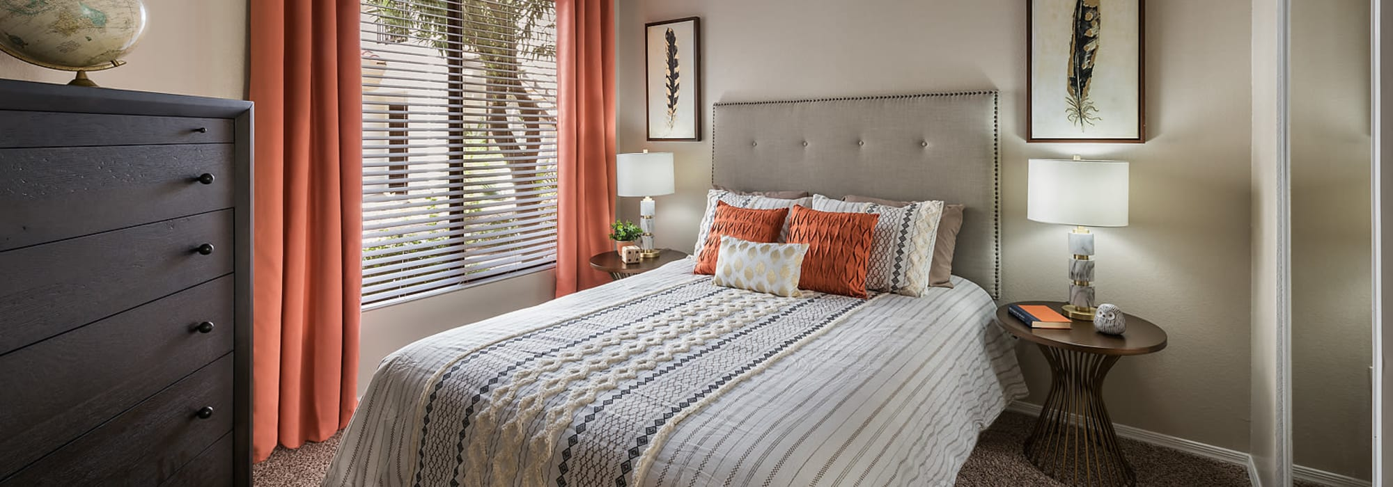 Modern luxury bedroom with furniture at San Palmas in Chandler, Arizona