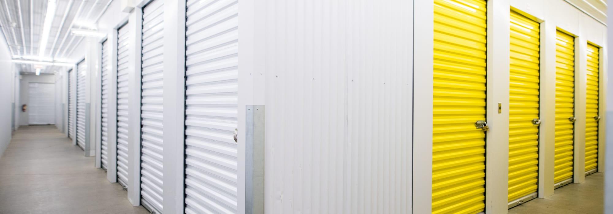 White and yellow unit doors at Apple Self Storage - Waterloo in Waterloo, Ontario