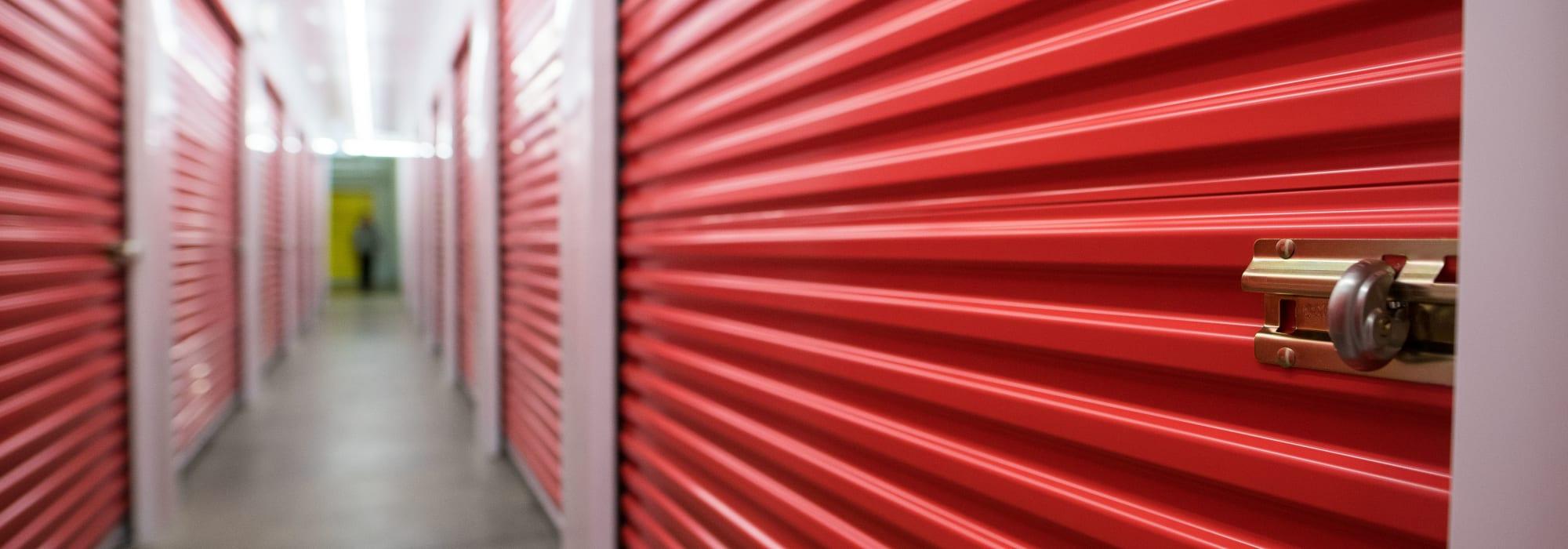 Red unit doors at Apple Self Storage - Waterloo in Waterloo, Ontario