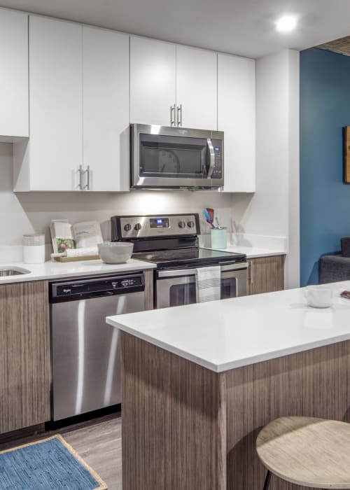 Kitchen with stainless steel appliances at RISE on Apache in Tempe, Arizona