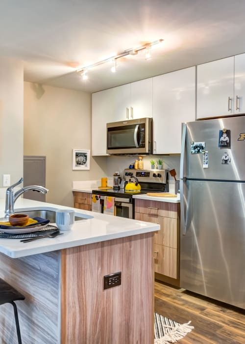 Kitchen with stainless steel appliances at RISE on Chauncey in West Lafayette, Indiana