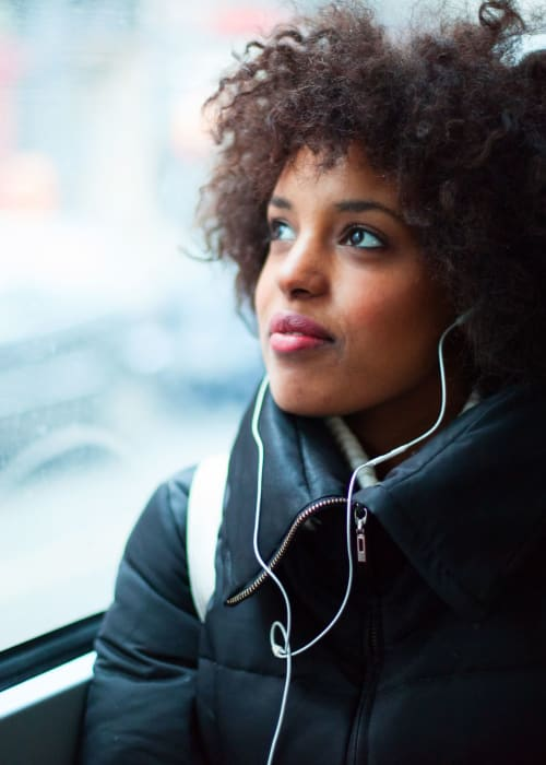 Student on her way to class with her headphone in near The View on Pavey Square in Columbus, Ohio