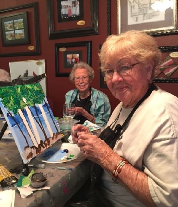 Assisted living residents at Juniper Springs Senior Living painting