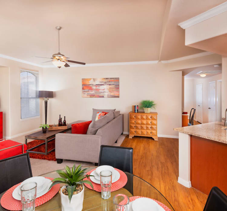 Beautiful living room and dining table at Villas on Hampton Avenue