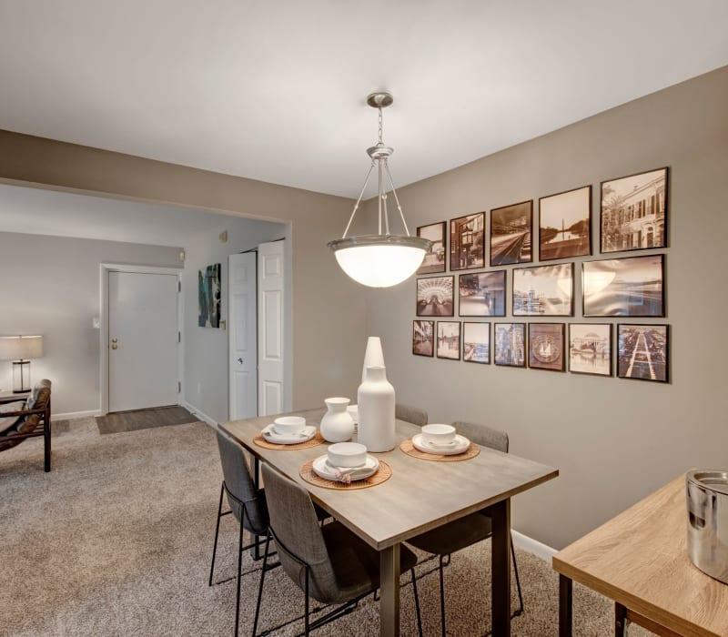 Well-furnished living room area with patio access at West Springfield Terrace in Springfield, Virginia