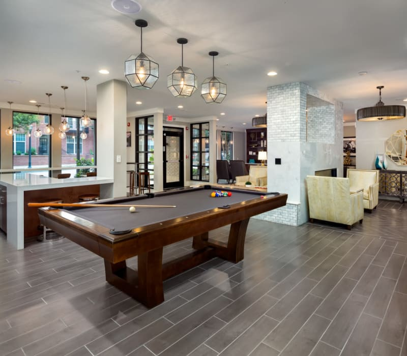 Pool table and shuffleboard with lots of seating areas in community clubhouse at Marq on Ponce in Atlanta, Georgia