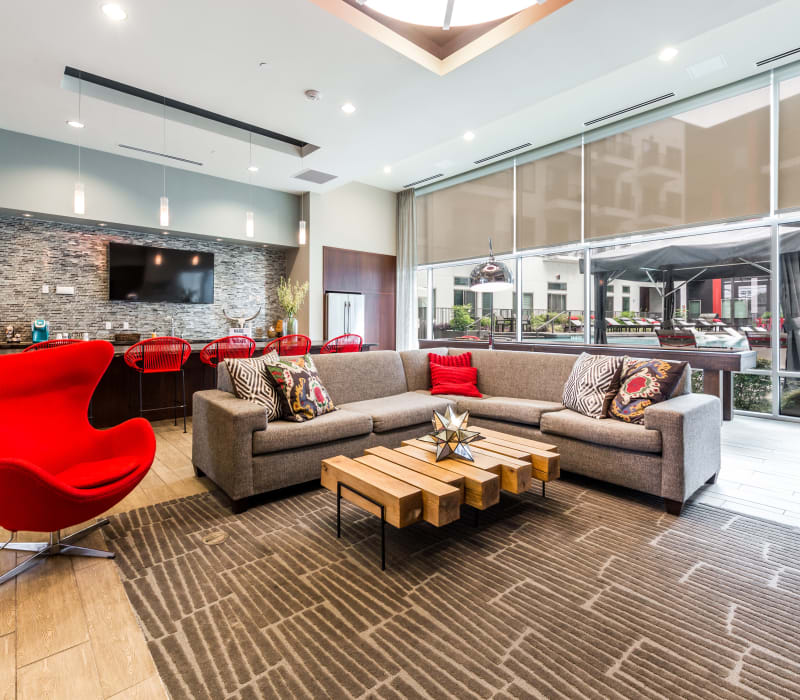 Sectional sofa with side chair and decorative coffee table in clubhouse at Marq on Burnet in Austin, Texas