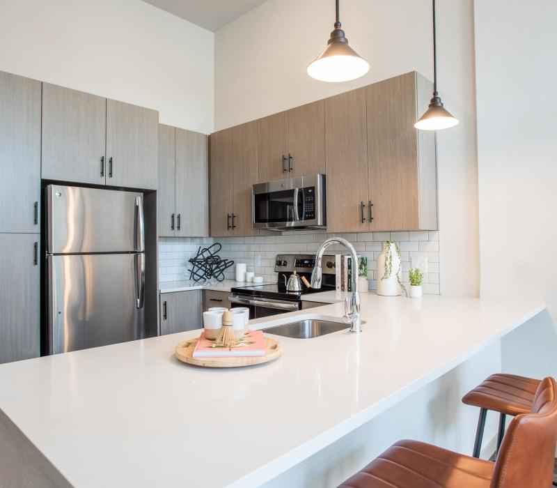 Kitchen island at Marq Iliff Station in Aurora, Colorado