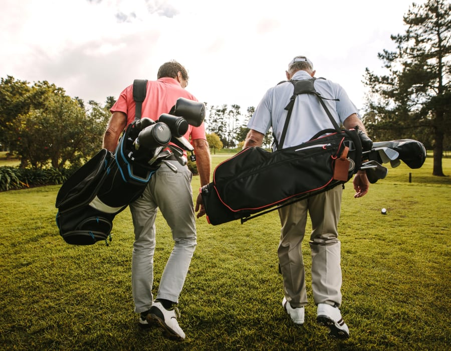 Residents playing a round of golf near Artistry at Craig Ranch in McKinney, Texas