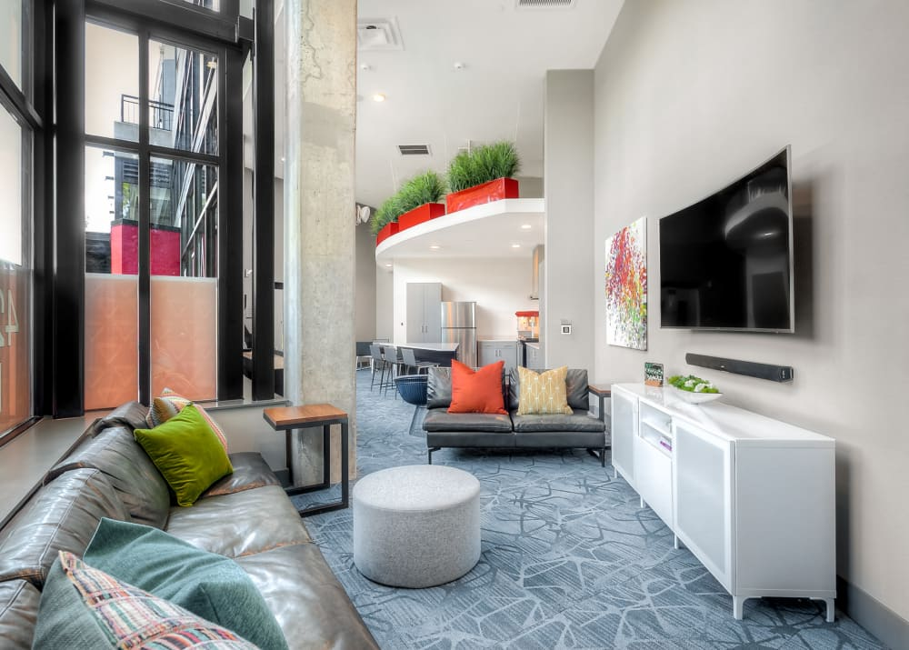 The modern clubhouse Lounge and Game Area with TV at Tria Apartments in Newcastle, WA