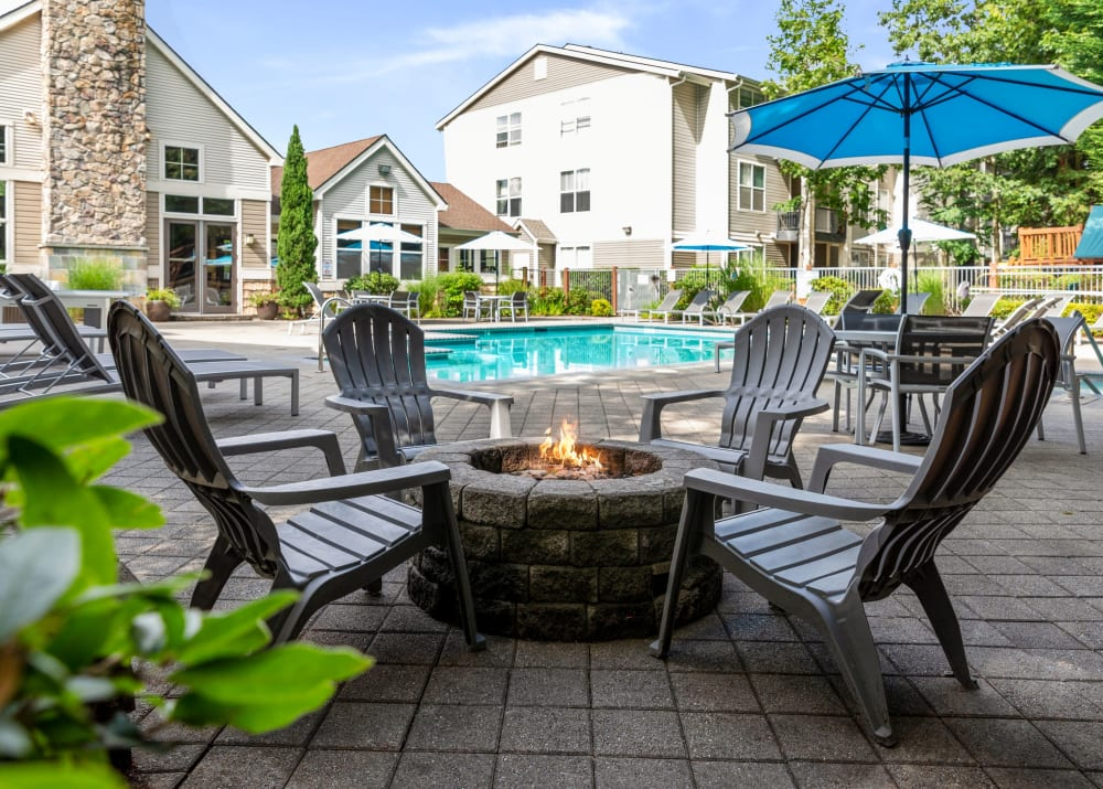 Fire Pit Lounge and Pool at Wildreed Apartments in Everett, WA
